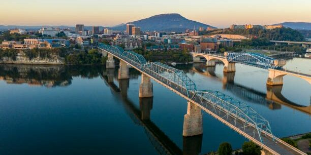 The Tennessee River winds around the banks of downtown Chattanooga TN at dawn